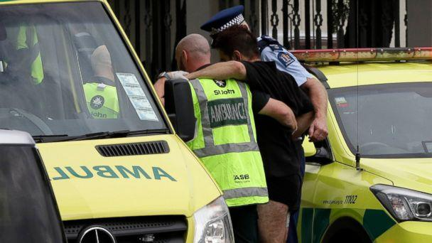 PHOTO: Police and ambulance staff help a wounded man from outside a mosque in central Christchurch, New Zealand, Friday, March 15, 2019. A witness says many people have been killed in a mass shooting at a mosque in the New Zealand city of Christchurch. (AP)