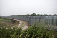FILE - In this Friday, May 21, 2021 file photo, a view of a steel wall at Evros river, near the village of Poros, at the Greek - Turkish border, Greece. Greece will further increase a border guard at its frontier with Turkey, fearing an upcoming spike in attempted illegal migration, officials said Monday, Oct. 11, 2021. (AP Photo/Giannis Papanikos, File)