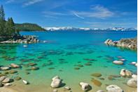 <p>Large boulders litter turquoise-colored waters of the eastern shoreline of Lake Tahoe in Nevada, United States.</p>