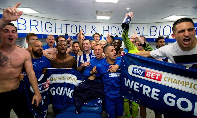 Brighton's squad and staff celebrate promotion following their 2-1 win against Wigan Athletic in the Championship match at the Amex Stadium in April last year.