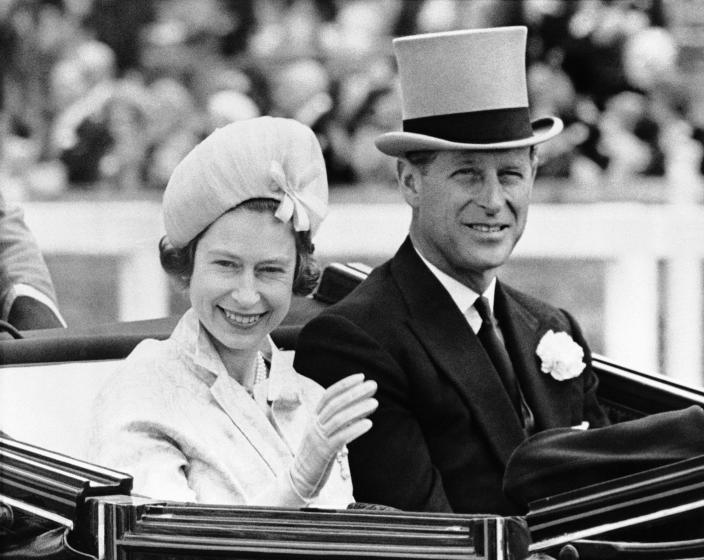 FILE - In this June 19, 1962 file photo, Britain's Prince Philip and his wife Queen Elizabeth II arrive at Royal Ascot race meeting, England. Buckingham Palace says Prince Philip, husband of Queen Elizabeth II, has died aged 99. Buckingham Palace says Prince Philip, husband of Queen Elizabeth II, has died aged 99. (AP Photo/File)