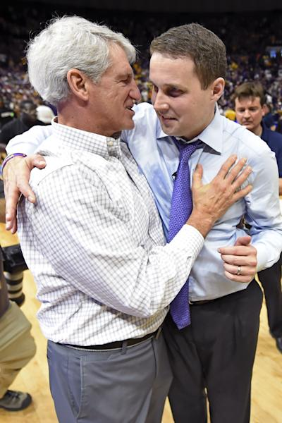 LSU Athletic Director Joe Alleva, left, hugs and has a word with LSU head coach Will Wade after an NCAA college basketball game, Saturday, Feb. 23, 2019, in Baton Rouge, La. LSU won in overtime 82-80.(AP Photo/Bill Feig)