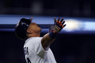 Detroit Tigers designated hitter Miguel Cabrera reacts after his sacrifice fly to center with the bases loaded during the eighth inning of a baseball game against the Baltimore Orioles, Friday, July 30, 2021, in Detroit. (AP Photo/Carlos Osorio)