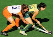 SYDNEY, AUSTRALIA - JULY 18: Lidewij Welten of the Netherlands and Hope Munro of Australia contest possession during the Women's Hockey Champions Trophy match between the Australian Hockeyroos and the Netherlands at Sydney Olympic Park Hockey Centre on July 18, 2009 in Sydney, Australia. (Photo by Mark Nolan/Getty Images)