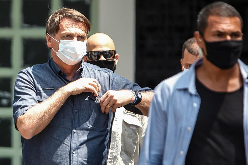 RIO DE JANEIRO, BRAZIL - NOVEMBER 15: President of Brazil Jair Bolsonaro (L) leaves after voting during the municipal elections at Vila Militar on November 15, 2020 in Rio de Janeiro, Brazil. (Photo by Luis Alvarenga/Getty Images)