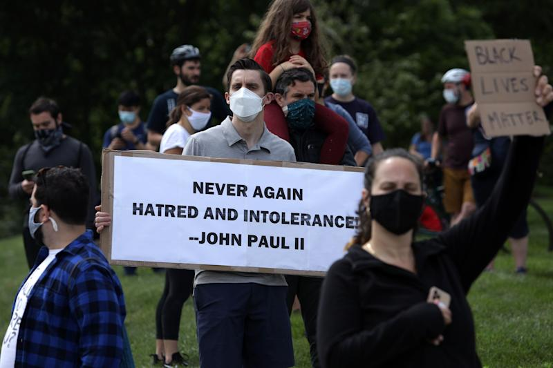 Demonstrators stage a protest near the Saint John Paul II National Shrine, which President Donald Trump visited on June 2 in Washington, D.C. (Photo: Alex Wong via Getty Images)