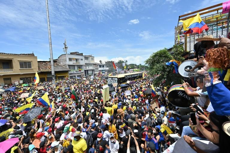 People protest against a proposed tax reform they say will leave them poorer as the country battles its deadliest phase yet of the coronavirus pandemic, in Cali, Colombia, on May 1, 2021