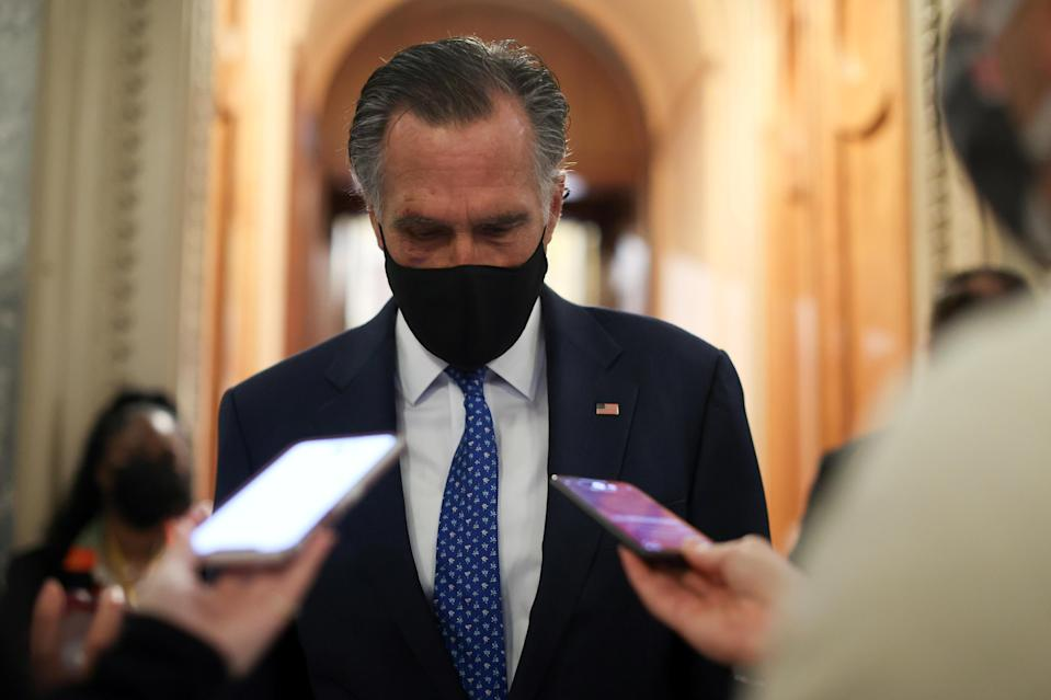 Senator Mitt Romney speaks with reporters at the U.S. Capitol on March 1, 2021. / Credit: JONATHAN ERNST / REUTERS