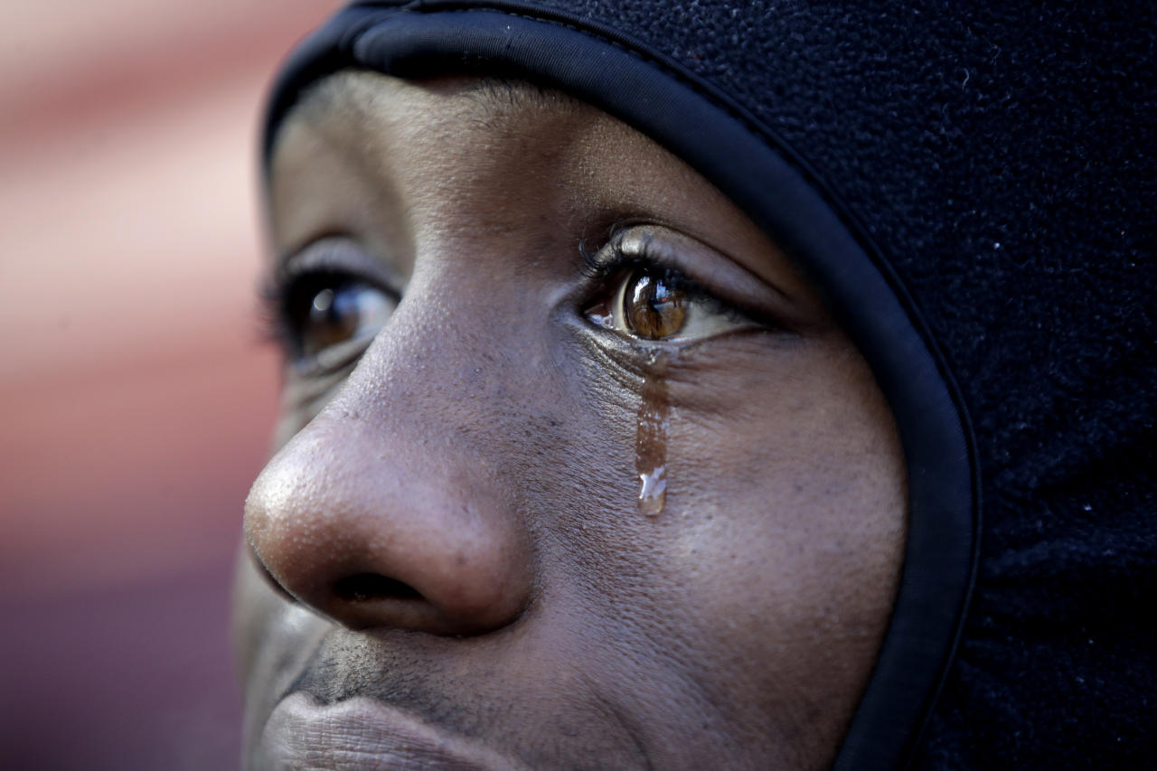 <p>A tear runs down the face of Kenyon George, whose girlfriend Shawntay Young, died during an apartment building fire a day earlier in the Bronx borough of New York, Friday, Dec. 29, 2017. (Photo: Julio Cortez/AP) </p>