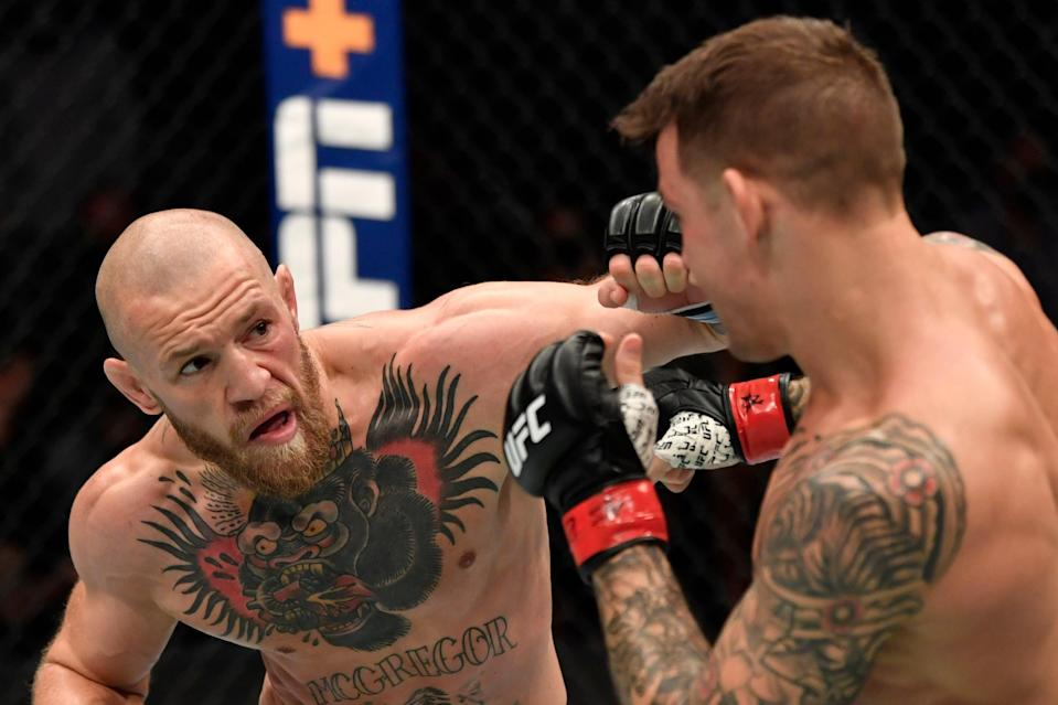 <p>Shock loss: Conor McGregor was upset by Dustin Poirier in their lightweight rematch at UFC 257</p> (Zuffa LLC via Getty Images)