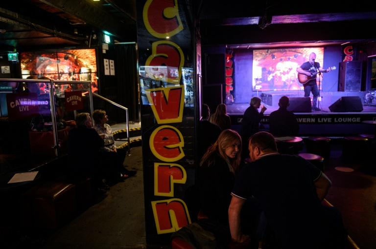 A musician plays Beatles songs in the Cavern Club where the audience only numbers 150 instead of the usual 500