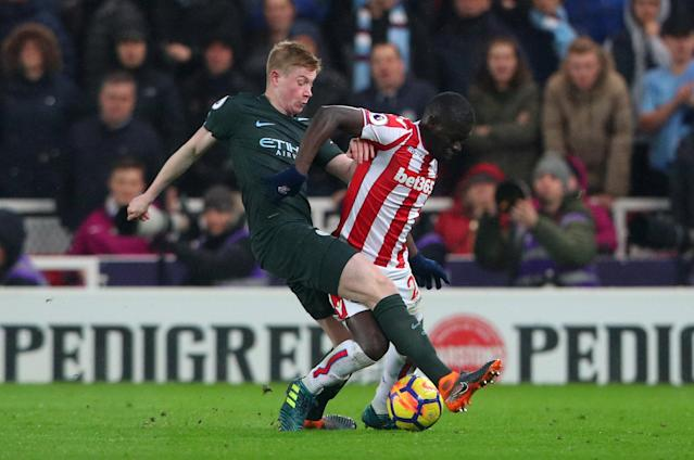 "Soccer Football - Premier League - Stoke City vs Manchester City - bet365 Stadium, Stoke-on-Trent, Britain - March 12, 2018 Manchester City's Kevin De Bruyne in action with Stoke City's Papa Ndiaye REUTERS/Hannah McKay EDITORIAL USE ONLY. No use with unauthorized audio, video, data, fixture lists, club/league logos or ""live"" services. Online in-match use limited to 75 images, no video emulation. No use in betting, games or single club/league/player publications. Please contact your account representative for further details."