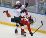 Anne Schleper of the United States (15) collides with Rebecca Johnston of Canada (6) during the second period of the women's gold medal ice hockey game at the 2014 Winter Olympics, Thursday, Feb. 20, 2014, in Sochi, Russia. (AP Photo/Petr David Josek)