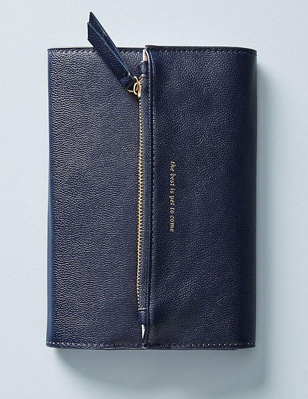 """<p>If busy bees or college students are on your list, give this sleek notebook to make their life easier. The faux leather book doubles as a wallet — what more could you want?<br /><strong><a rel=""""nofollow"""" href=""""https://fave.co/2QlA5F9"""">SHOP IT</a>:</strong> $34, <a rel=""""nofollow"""" href=""""https://fave.co/2QlA5F9"""">anthropologie.com</a> </p>"""