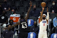 Los Angeles Clippers forward Marcus Morris Sr. (8) makes a 3-point basket over Toronto Raptors forward Pascal Siakam (43) during the first half of an NBA basketball game Tuesday, May 4, 2021, in Los Angeles. (AP Photo/Marcio Jose Sanchez)