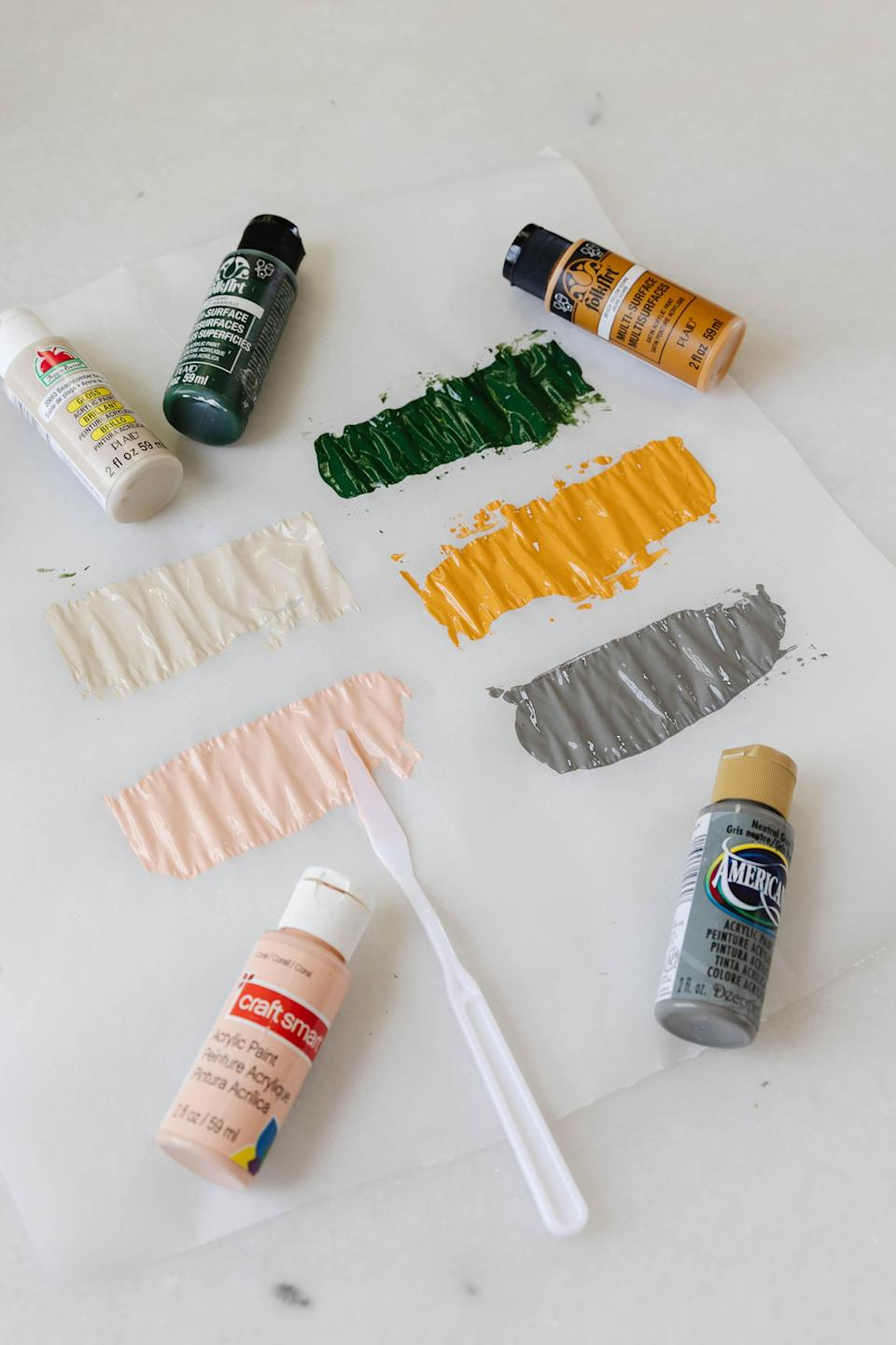 Start by painting on wax paper.