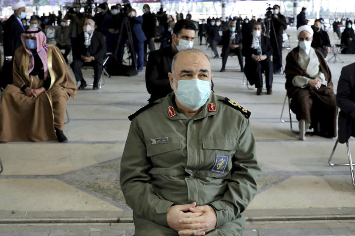 Chief of Iran's Revolutionary Guard Gen. Hossein Salami wearing a mask, attends a ceremony on the occasion of first anniversary of death of late Iranian Revolutionary Guards Corps (IRGC) general and commander of the Quds Force Qasem Soleimani, in Tehran, Iran, Friday, Jan. 1, 2021. The top commander of Iran's paramilitary Revolutionary Guard said Friday that his country was fully prepared to respond to any U.S. military pressure, amid heightened tensions between Tehran and Washington in the waning days of President Donald Trump's administration. (AP Photo/Ebrahim Noroozi)