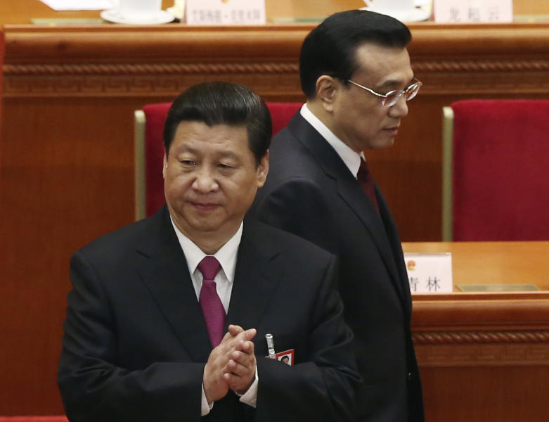 China's new President Xi Jinping, left, and newly installed Premier Li Kiqiang arrive to the closing session of the National People's Congress at the Great Hall of the People in Beijing China, Sunday, March 17, 2013. China's new leader pledged a cleaner, more efficient government Sunday as the country's ceremonial legislature wrapped up a pivotal session that installed the latest generation of communist leaders in a once-a-decade transfer of power. (AP Photo/Kin Cheung)