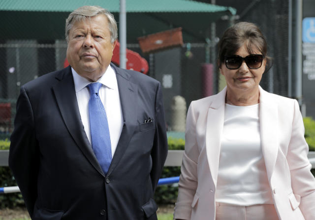 Viktor and Amalija Knavs listen as their attorney makes a statement in New York, Thursday, Aug. 9, 2018. First lady Melania Trump's parents have been sworn in as U.S. citizens. A lawyer for the Knavs says the Slovenian couple took the citizenship oath on Thursday in New York City. They had been living in the U.S. as permanent residents. (Photo: Seth Wenig/AP)
