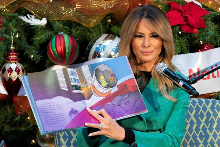 <p>Melania Trump reads a holiday story to hospitalised children on 15 December.</p> (REUTERS)