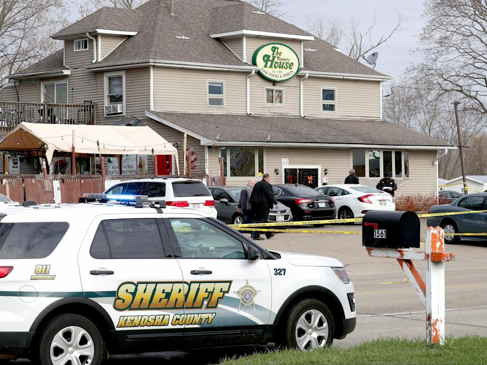 <p>Officials investigate the scene a deadly shooting at Somers House Tavern in Kenosha, Wisconsin on Sunday, 18 April, 2021</p> (AP)