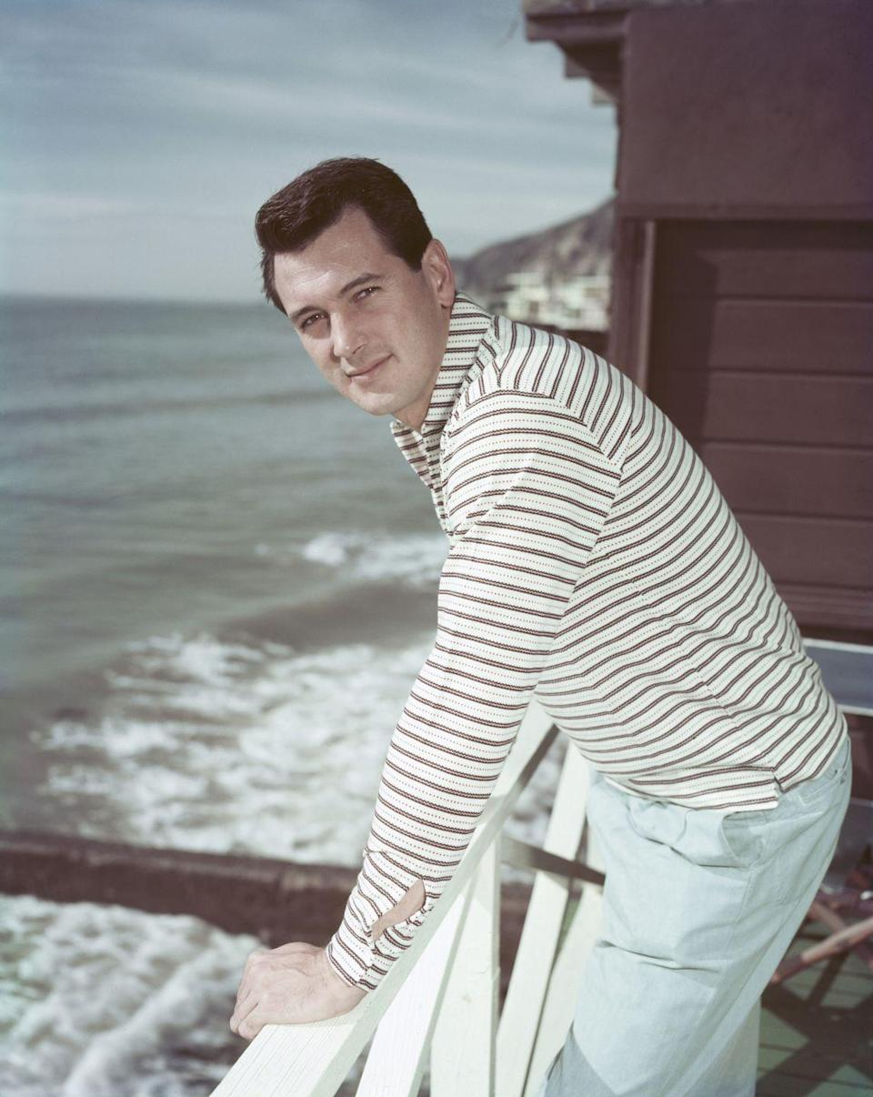 <p>Rock Hudson relaxes on the deck of his beach house in Malibu, California, circa 1958.</p>