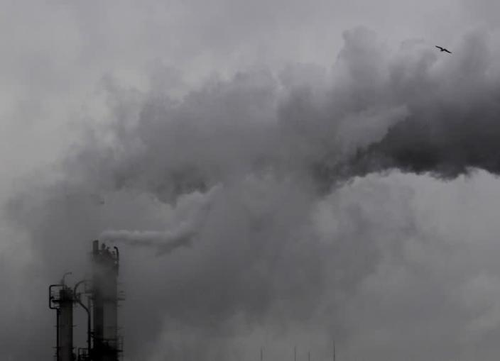 FILE PHOTO: Smoke billows from chimneys at an industrial district near Tokyo