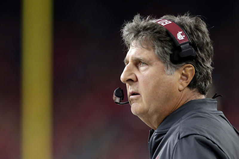 FILE - In this Sept. 13, 2019, file photo, Washington State head coach Mike Leach watches during the second half of an NCAA college football game against Houston, in Houston. Two people with knowledge of the decision says Mississippi State has hired Washington State's Mike Leach as its new head coach.  The people spoke to The Associated Press on condition of anonymity Thursday, Jan. 9, 2020, because the school has not yet officially announced the move. Leach will replace Joe Moorhead, who was fired last week after two seasons. (AP Photo/Michael Wyke, File)