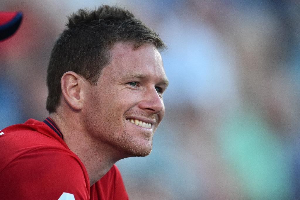 England's Eoin Morgan smiles as he watches the run chase during the T20 international cricket match between England and South Africa at The Ageas Bowl in Southampton, on the south coast of England, on June 21, 2017 (AFP Photo/Glyn KIRK)