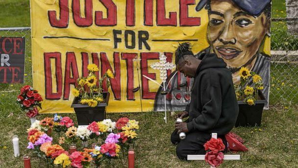 PHOTO: Antwon Davis lights candles at a memorial for Daunte Wright, May 2, 2021, in Brooklyn Center, Minn. (Stephen Maturen/Getty Images, FILE)