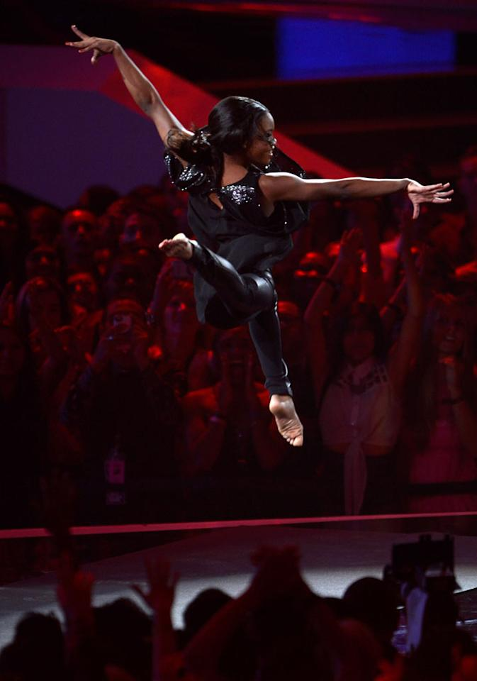 LOS ANGELES, CA - SEPTEMBER 06:  Gabby Douglas performs onstage while Alicia Keys sings during the 2012 MTV Video Music Awards at Staples Center on September 6, 2012 in Los Angeles, California.  (Photo by Kevin Mazur/WireImage)
