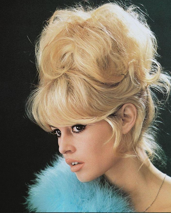 <p>Unlike the neat, polished updos of years prior, women opted for messier, imperfect styles to achieve a sexy look in the '60s.</p>