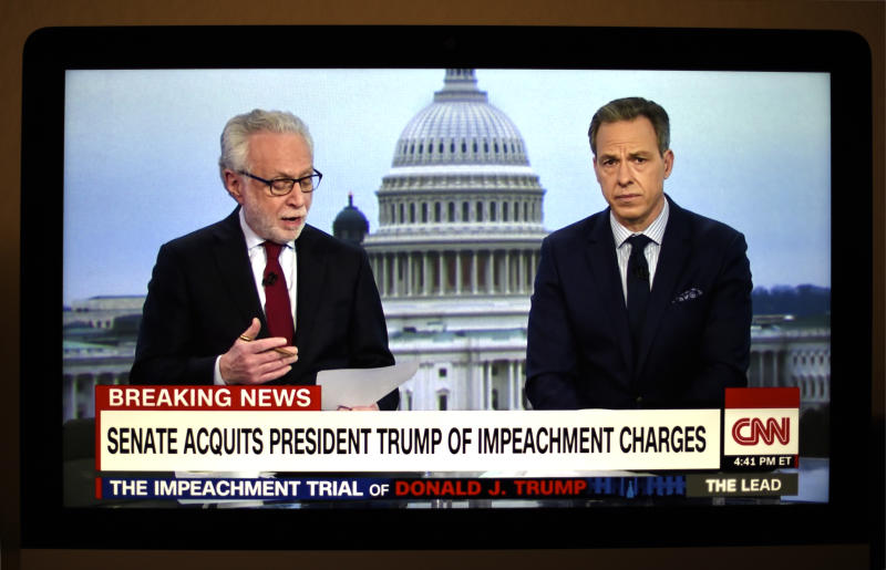 FEBRUARY 5, 2020: A television screen shot during live CNN coverage of the President Donald Trump impeachment trial on February 5, 2020, shows CNN news anchors Wolf Blitzer and Jake Tapper moments after the final vote in the U.S. Senate which acquitted Trump of two articles of impeachment. (Photo by Robert Alexander/Getty Images)