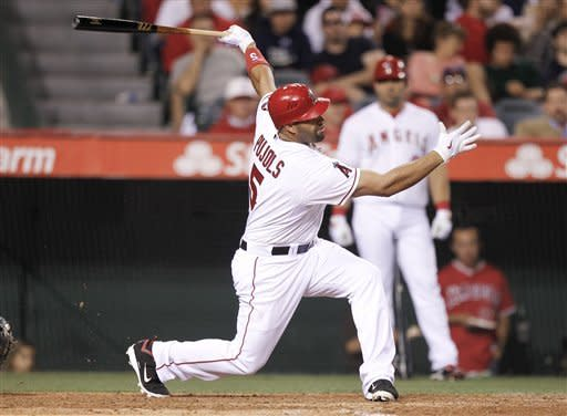 Los Angeles Angels' Albert Pujols strikes out against the Oakland Athletics during the sixth inning of a baseball game in Anaheim, Calif., Monday, May 14, 2012. (AP Photo/Chris Carlson)