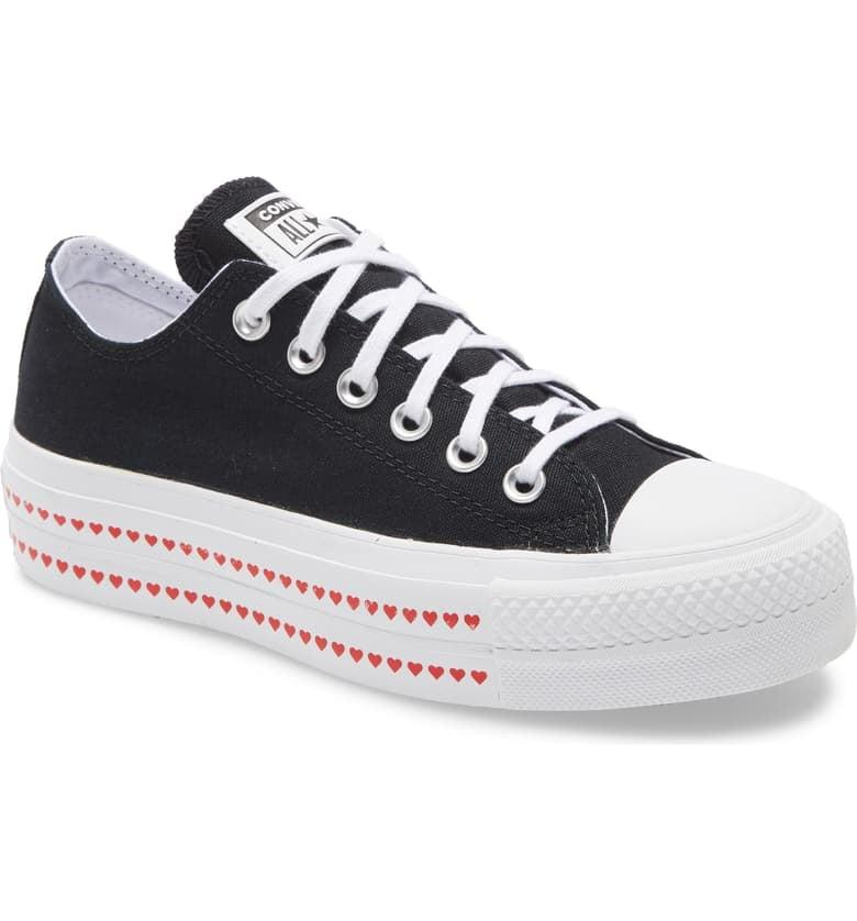 """<p>The hearts on the soles of these <a href=""""https://www.popsugar.com/buy/Converse-Chuck-Taylor-All-Star-Love-Fearlessly-Platform-Sneakers-549355?p_name=Converse%20Chuck%20Taylor%20All%20Star%20Love%20Fearlessly%20Platform%20Sneakers&retailer=shop.nordstrom.com&pid=549355&price=70&evar1=fab%3Aus&evar9=47219648&evar98=https%3A%2F%2Fwww.popsugar.com%2Ffashion%2Fphoto-gallery%2F47219648%2Fimage%2F47221037%2FConverse-Chuck-Taylor-All-Star-Love-Fearlessly-Platform-Sneakers&list1=shopping%2Cnordstrom%2Cshoes%2Csneakers&prop13=api&pdata=1"""" rel=""""nofollow"""" data-shoppable-link=""""1"""" target=""""_blank"""" class=""""ga-track"""" data-ga-category=""""Related"""" data-ga-label=""""https://shop.nordstrom.com/s/converse-chuck-taylor-all-star-love-fearlessly-platform-sneaker-women/5419087/full?origin=category-personalizedsort&amp;breadcrumb=Home%2FWomen%2FShoes%2FSneakers%20%26%20Athletic&amp;color=black%2F%20university%20red%2F%20white"""" data-ga-action=""""In-Line Links"""">Converse Chuck Taylor All Star Love Fearlessly Platform Sneakers</a> ($70) are so freakin' cute.</p>"""