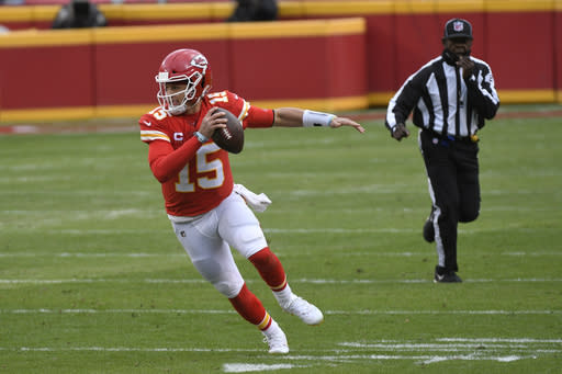 Kansas City Chiefs quarterback Patrick Mahomes scrambles up field during the first half of an NFL divisional round football game against the Cleveland Browns, Sunday, Jan. 17, 2021, in Kansas City. (AP Photo/Reed Hoffmann)