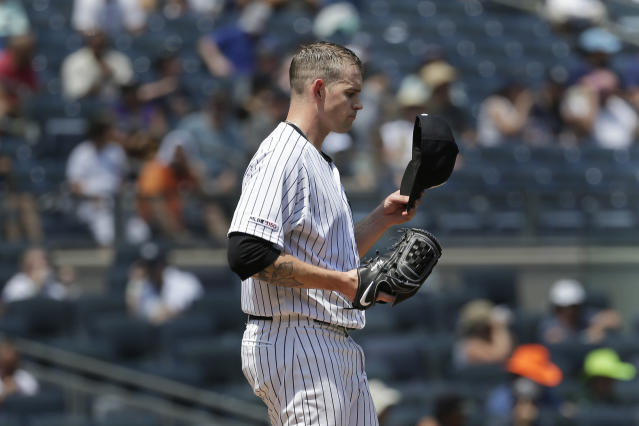 New York Yankees starting pitcher James Paxton reacts during the third inning of a baseball game against the Colorado Rockies at Yankee Stadium, Sunday, July 21, 2019, in New York. (AP Photo/Seth Wenig)