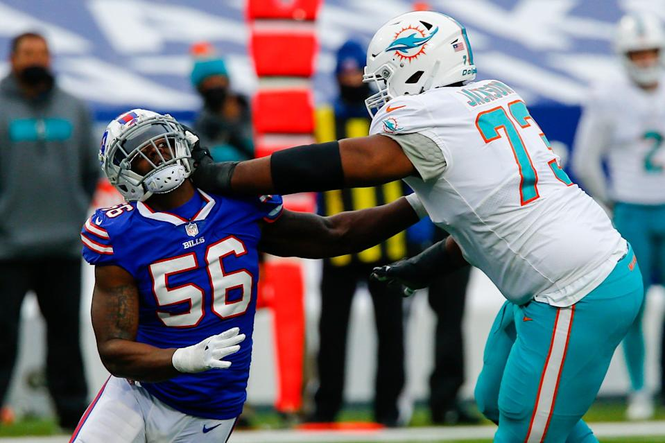 Buffalo Bills defensive end Mike Love (56) is blocked by Miami Dolphins offensive tackle Austin Jackson (73) in the first half of an NFL football game, Sunday, Jan. 3, 2021, in Orchard Park, N.Y.