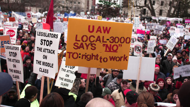 Union members from around the country rally at the Michigan State Capitol to protest a vote on Right-to-Work legislation December 11, 2012 in Lansing, Michigan. Republicans control the Michigan House of Representatives, and Michigan Gov. Rick Snyder has said he will sign the bill if it is passed. The new law would make requiring financial support of a union as a condition of employment illegal. (Photo by Bill Pugliano/Getty Images)