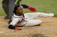 Atlanta Braves' Ozzie Albies scores on a double by Dansby Swanson during the sixth inning in Game 4 of a baseball National League Championship Series Los Angeles Dodgers Thursday, Oct. 15, 2020, in Arlington, Texas. (AP Photo/Tony Gutierrez)