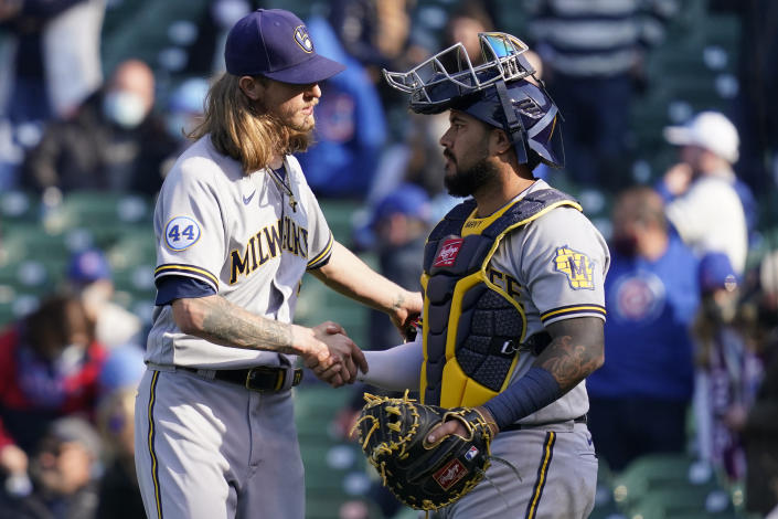 Milwaukee Brewers relief pitcher Josh Hader, left, celebrates with catcher Omar Narvaez after they defeated the Chicago Cubs in a baseball game in Chicago, Saturday, April 24, 2021. (AP Photo/Nam Y. Huh)
