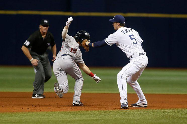 ST. PETERSBURG, FL - AUGUST 24: Shortstop Matt Duffy #5 of the Tampa Bay Rays tags out Andrew Benintendi #40 of the Boston Red Sox after Dustin Pedroia grounded into the double play during the seventh inning of a game on August 24, 2016 at Tropicana Field in St. Petersburg, Florida. (Photo by Brian Blanco/Getty Images)