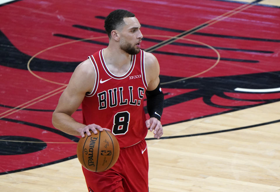 Feb 20, 2021; Chicago, Illinois, USA; Chicago Bulls guard Zach LaVine (8) dribbles the ball against the Sacramento Kings during the second quarter at the United Center.