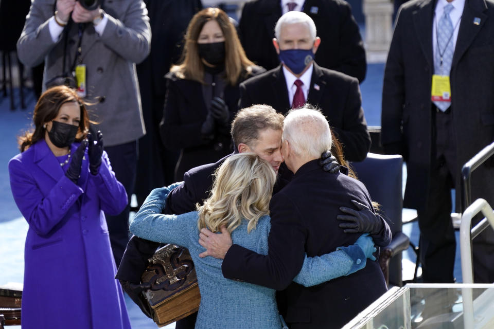 President Joe Biden hugs first lady Jill Biden, his son Hunter Biden and daughter Ashley Biden after being sworn-in during the 59th Presidential Inauguration at the U.S. Capitol in Washington, Wednesday, Jan. 20, 2021. Vice President Kamala Harris applauds at left. (AP Photo/Carolyn Kaster)