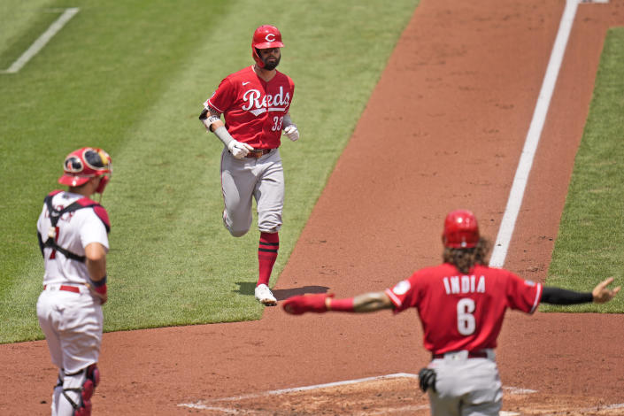 Cincinnati Reds' Jesse Winker (33) rounds the bases after hitting a two-run home run as teammate Jonathan India (6) and St. Louis Cardinals catcher Andrew Knizner, left, wait at home during the second inning of a baseball game Sunday, June 6, 2021, in St. Louis. (AP Photo/Jeff Roberson)