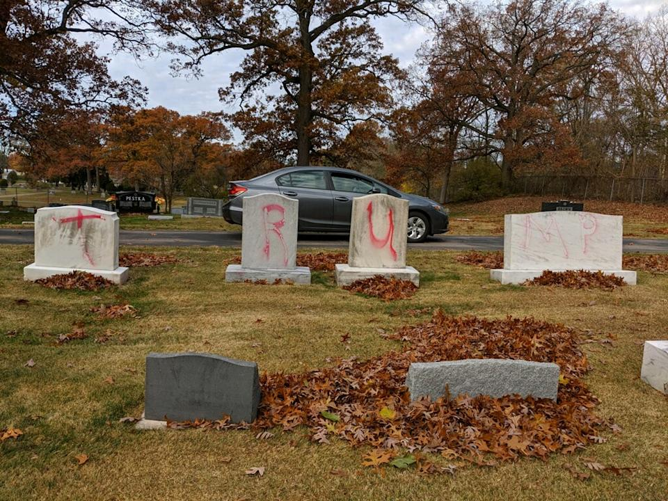 'TRUMP' painted in red across four graves at a Michigan cemetery.