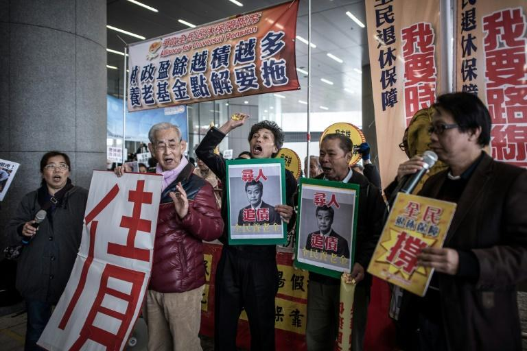 Demonstrators protest against the new budget outside the government buildings in Hong Kong, on February 24, 2016