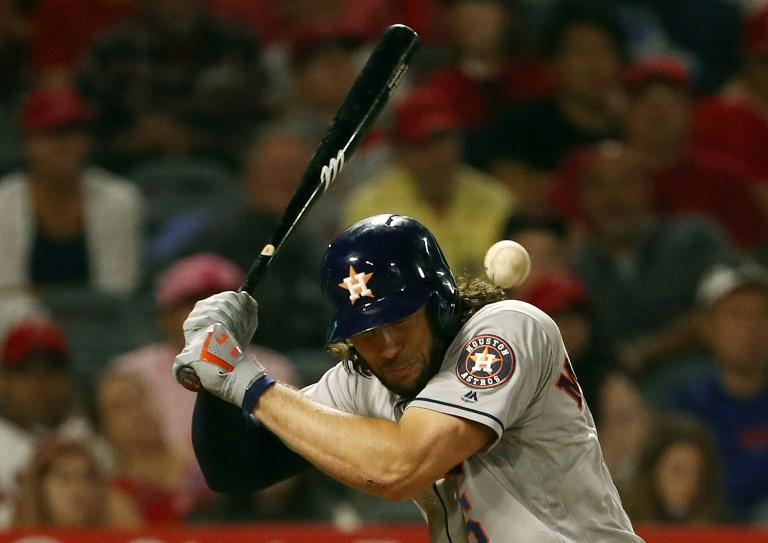Houston Astros outfielder Jake Marisnick is struck by a pitch in his team's game against the Los Angeles Angels