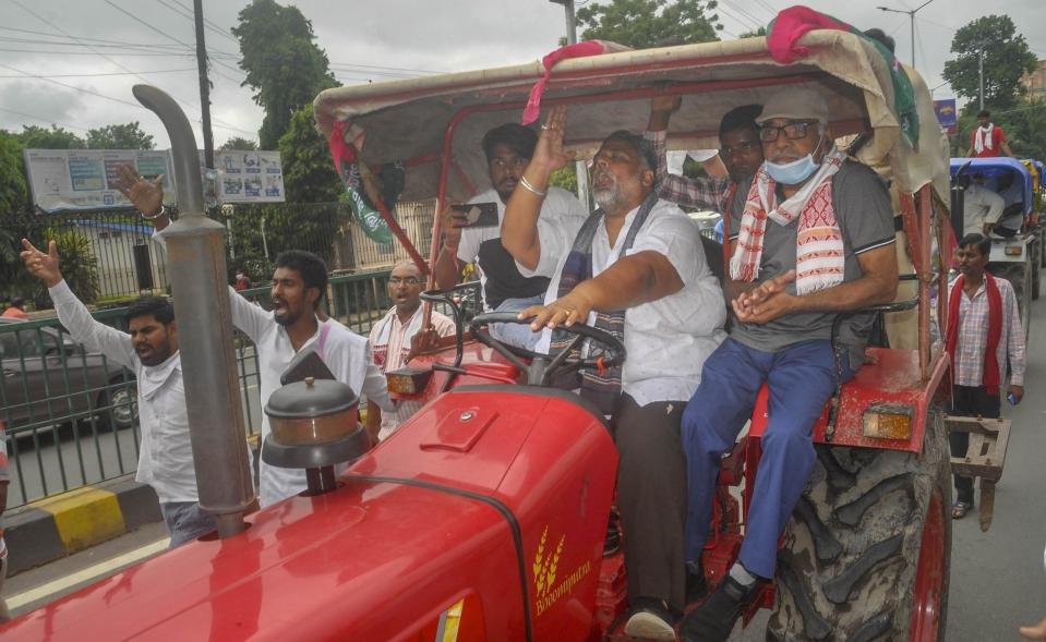 Jan Adhikar Party Chief Pappu Yadav rides a tractor during 'Bharat Bandh', a protest against the farm bills passed in Parliament recently, in Patna, Friday, Sept. 25, 2020. (PTI Photo)