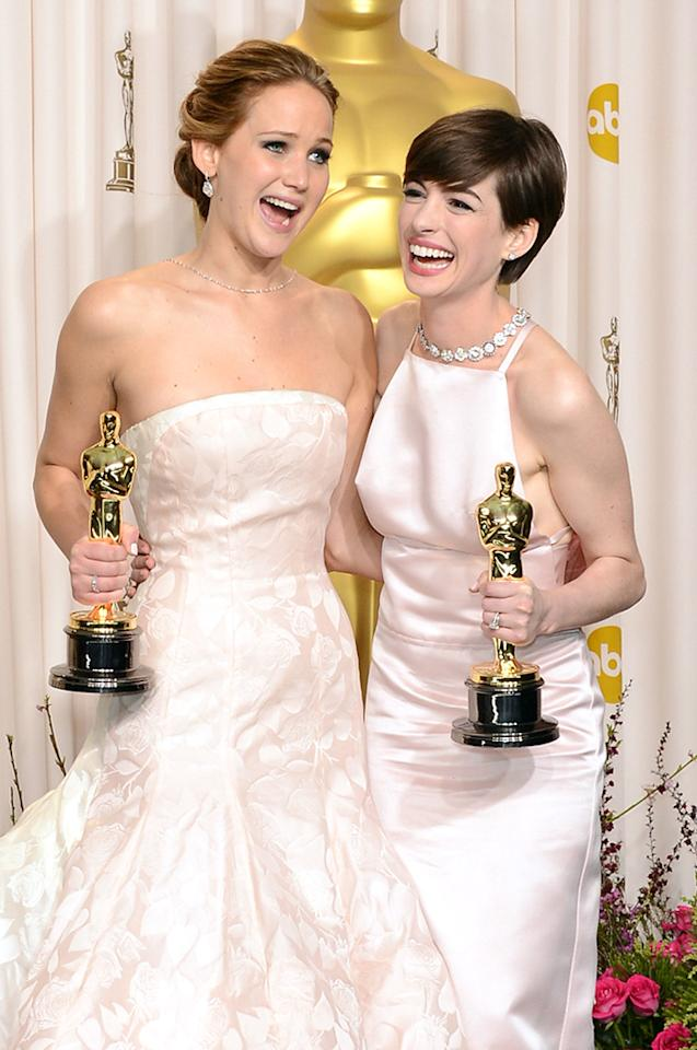 "Jennifer Lawrence (L), winner of the Best Actress award for ""Silver Linings Playbook,"" and Anne Hathaway, winner of the Best Supporting Actress award for ""Les Miserables,"" pose in the press room during the Oscars held at Loews Hollywood Hotel on February 24, 2013 in Hollywood, California."